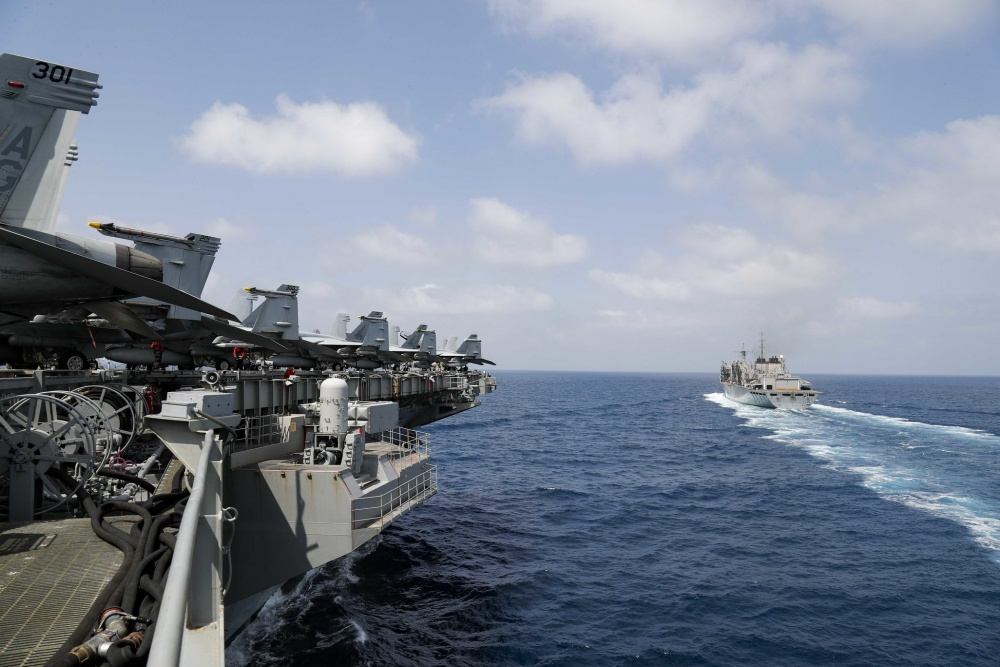 The Nimitz-class aircraft carrier USS Abraham Lincoln (CVN 72) pulls alongside the fast combat support ship USNS Arctic (T-AOE 8) prior to a replenishment-at-sea.
