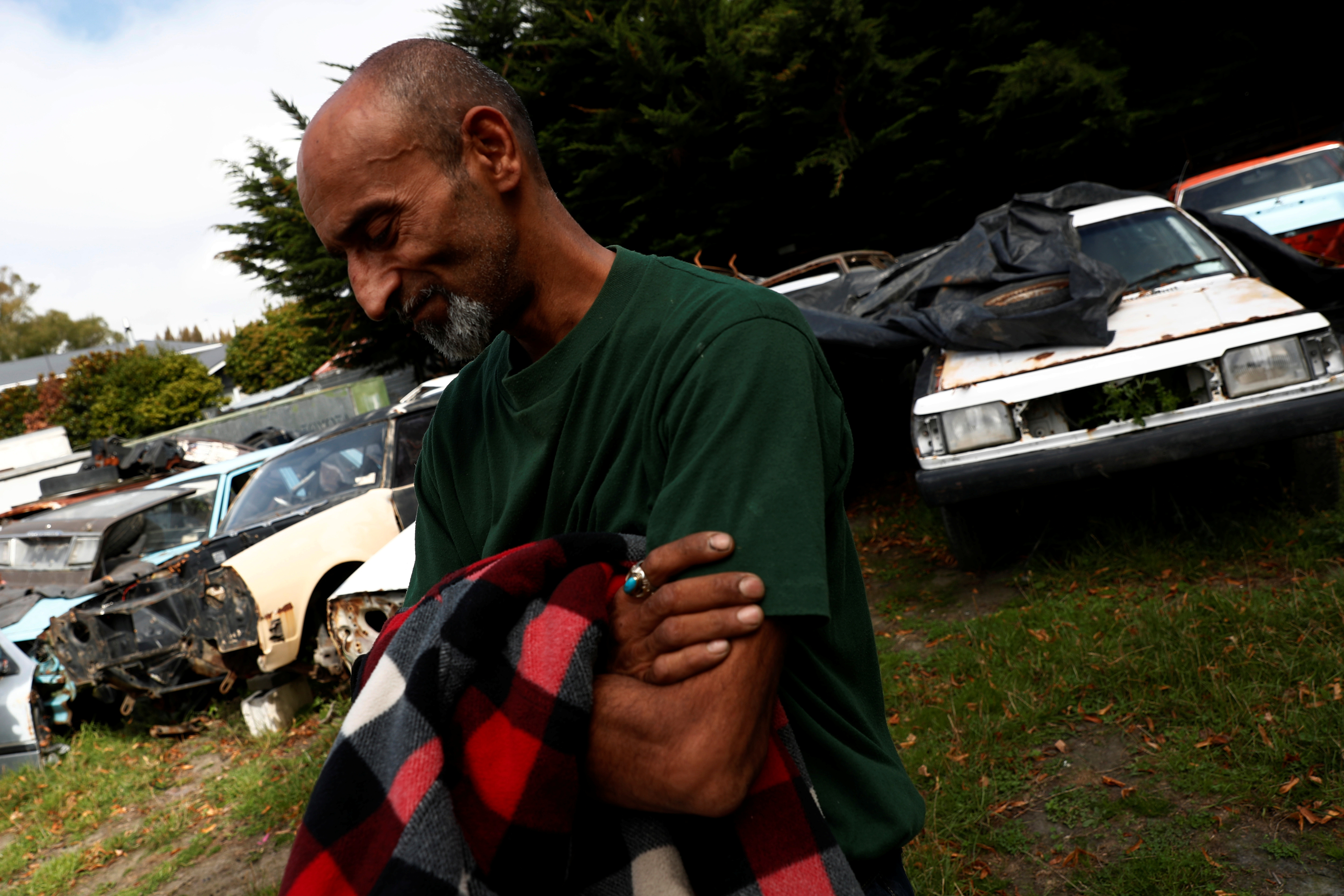 Omar Nabi, 43, originally from Afghanistan, takes a moment to recompose himself as he speaks about his late father, Haji-Daoud Nabi's love for cars at Haji-Daoud's property in Christchurch, New Zealand March 31, 2019.