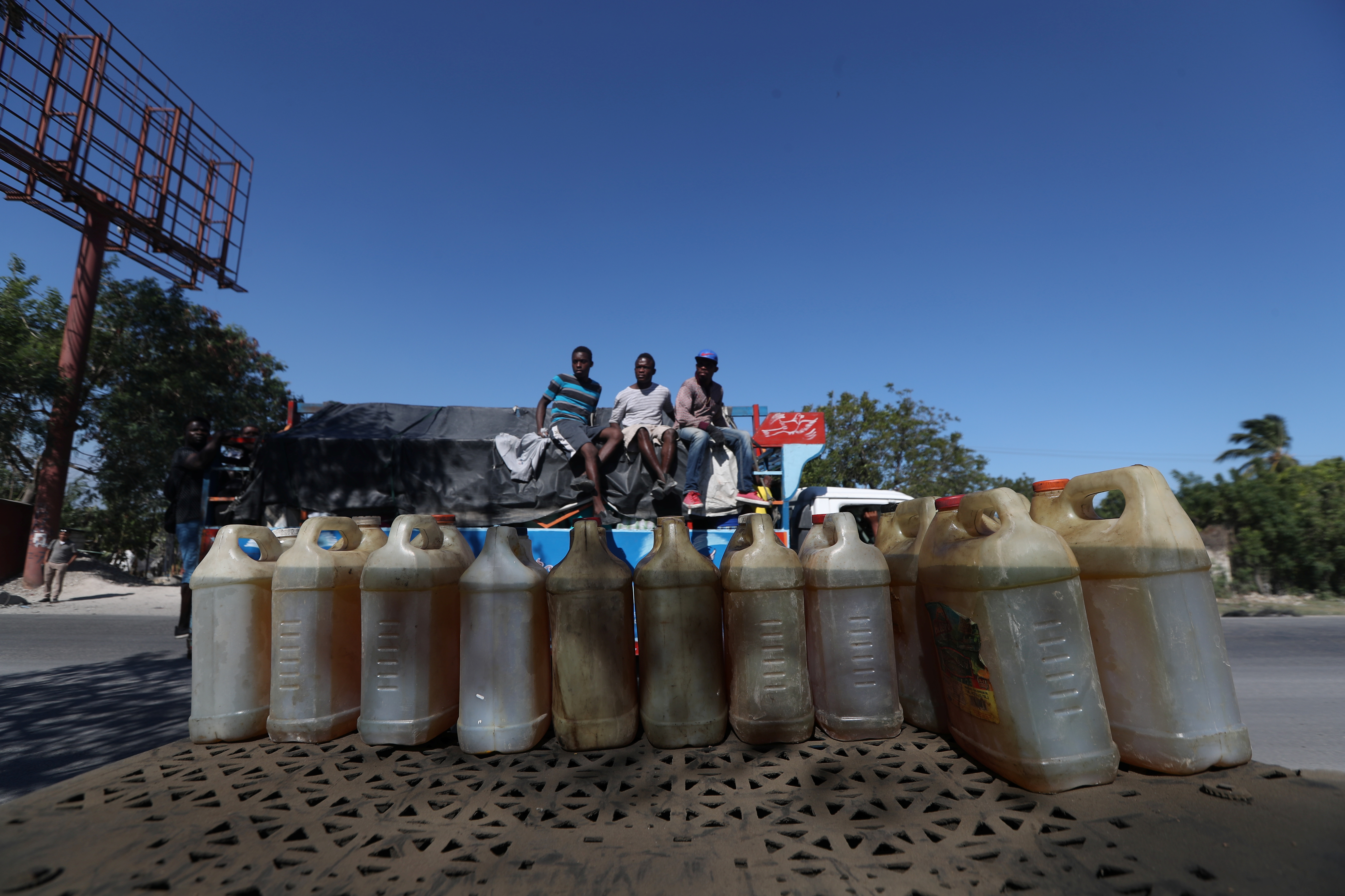 Containers filled with fuel that is sold on the black market are offered in a street in Port-au-Prince, Haiti, February 24, 2019.