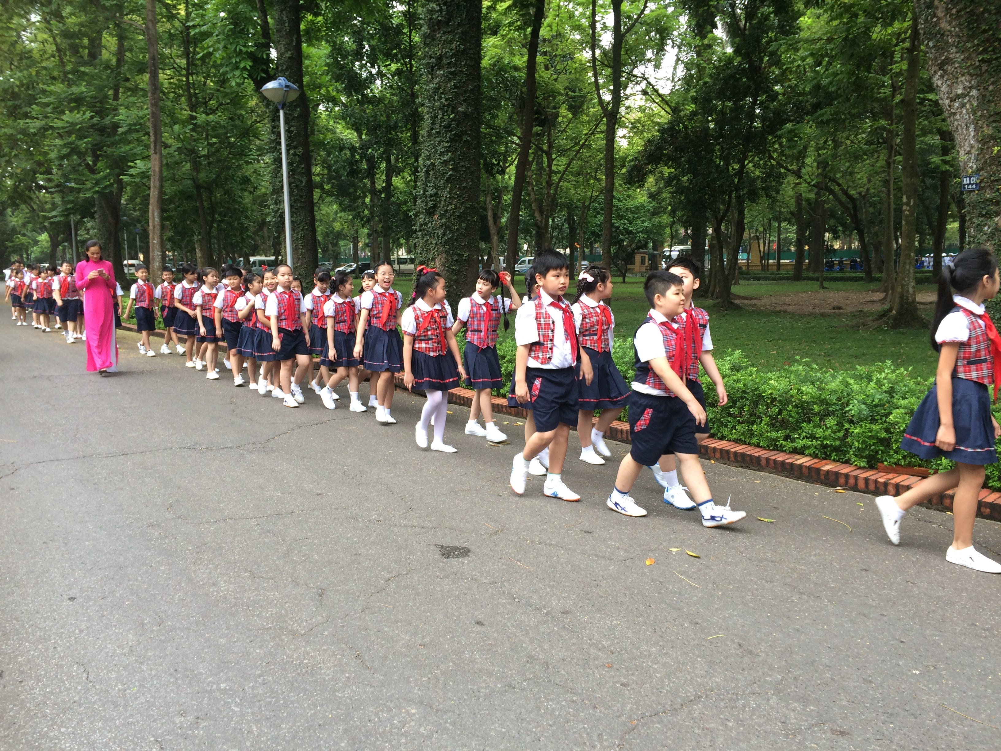 Schoolchildren walk through a road in Hanoi. Advocates say feminism should be taught to any gender, such as by encouraging compassion in boys.