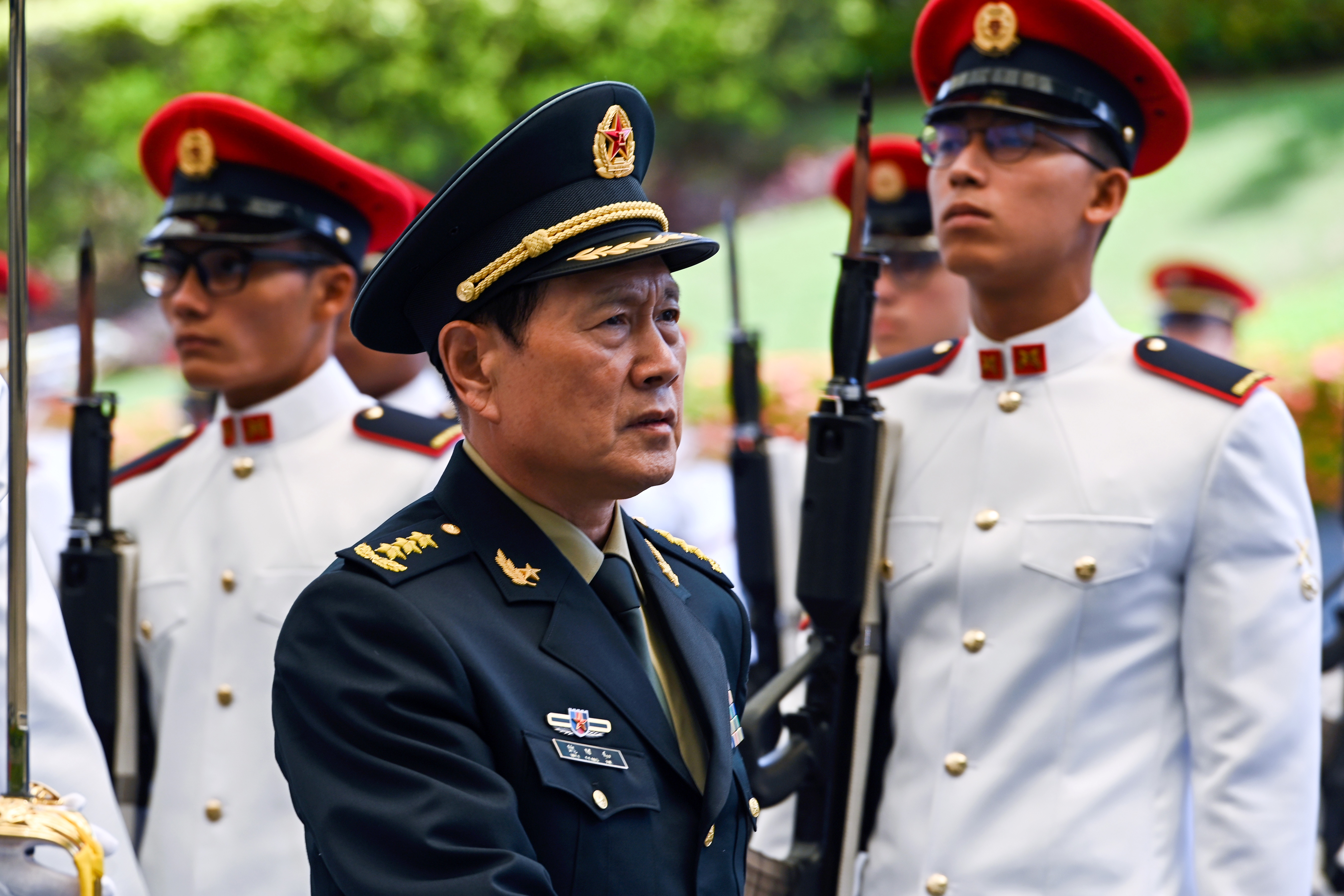 Chinese Defense Minster Wei Fenghe inspects the honor guard during a welcoming ceremony at the Ministry of Defense in Singapore, May 29, 2019.