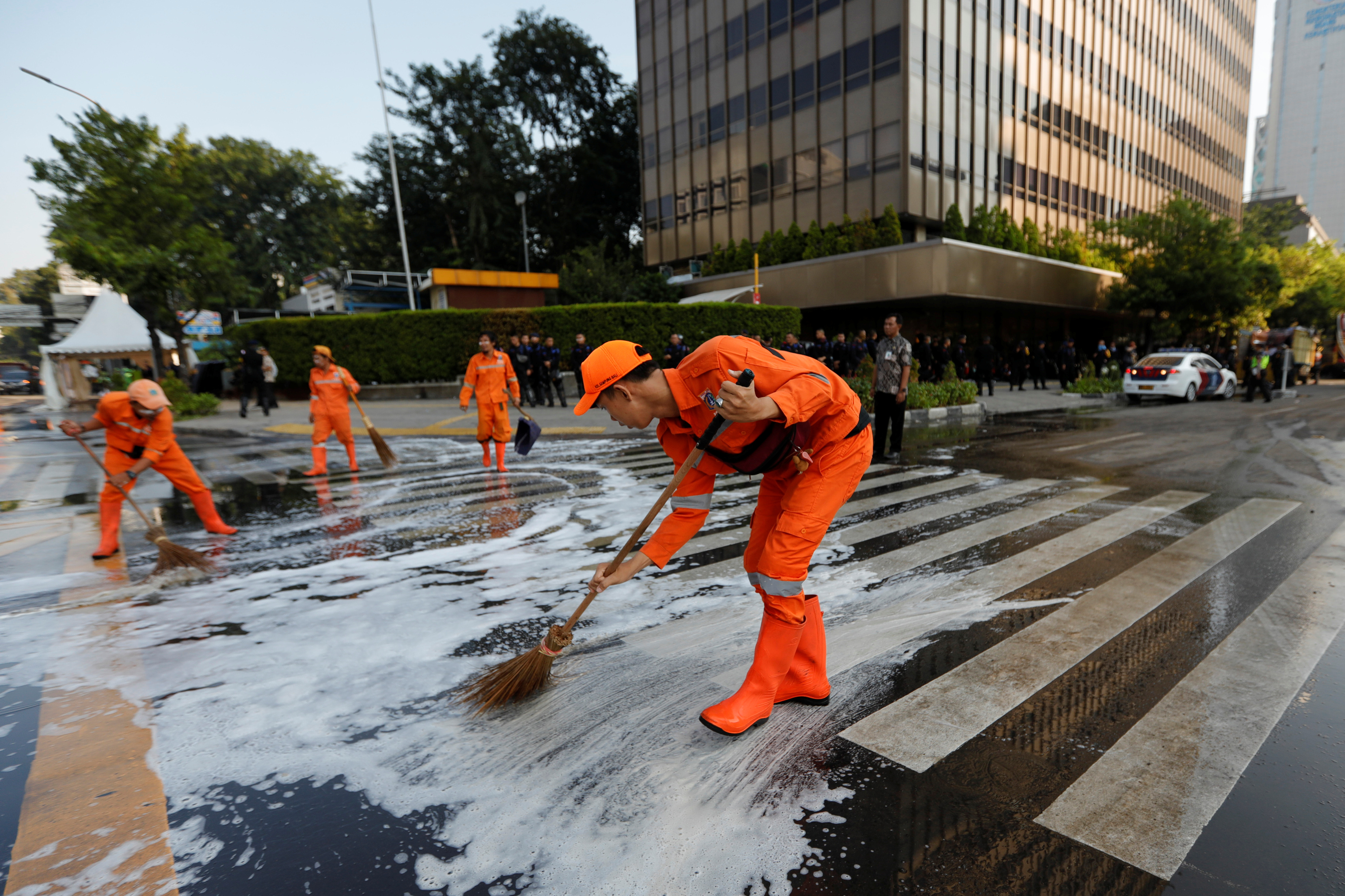 Workers clean the road after a riot outside Indonesia's Election Supervisory Agency headquarters following the announcement of last month's presidential election results in Jakarta, Indonesia, May 23, 2019.