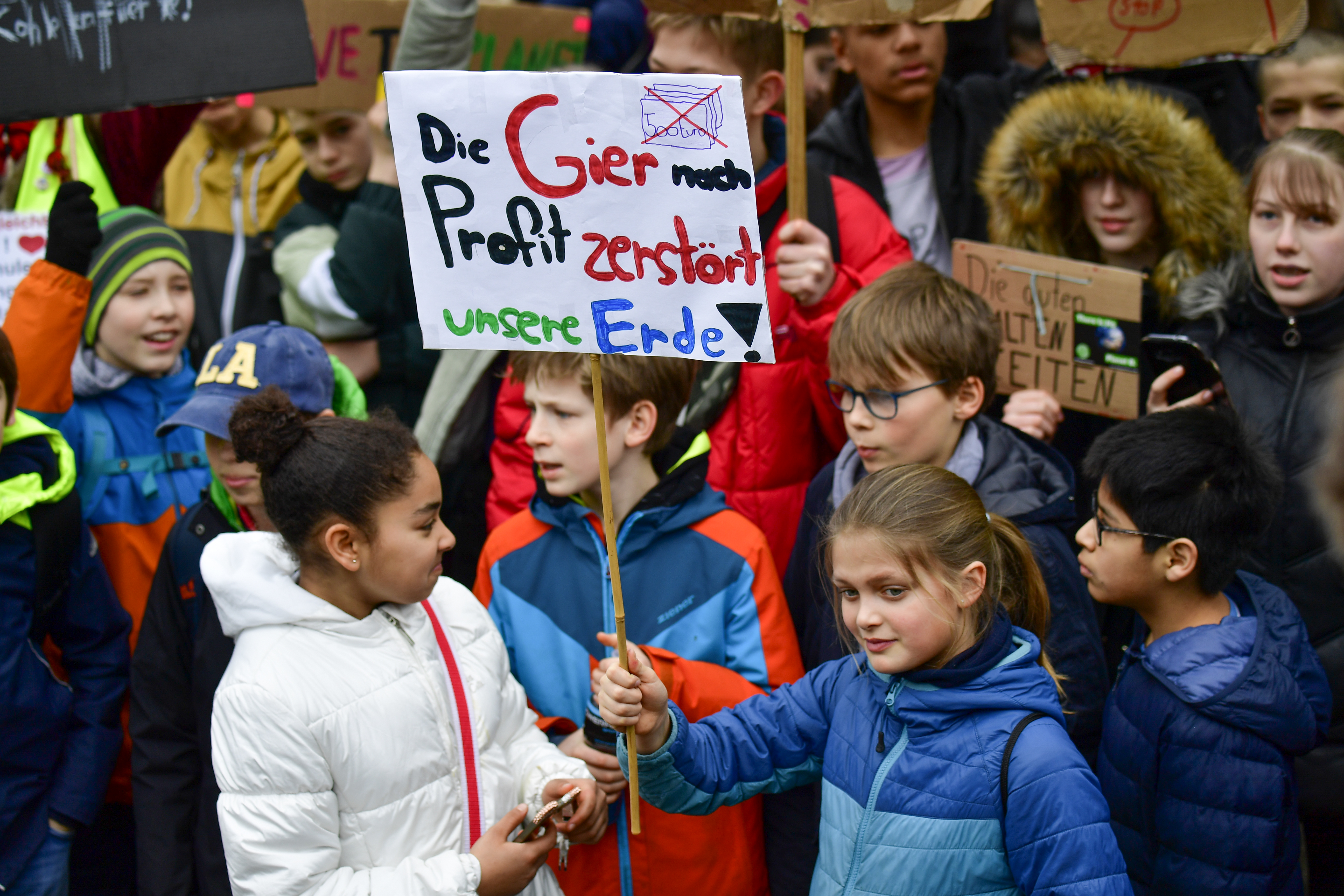 """FILE - Youths demonstrate with a banner reading """"the greed for profit destroys our earth!"""" during the """"Fridays For Future"""" movement on a global day of student protests aiming to spark world leaders into action on climate change on March 15, 2019 in B..."""