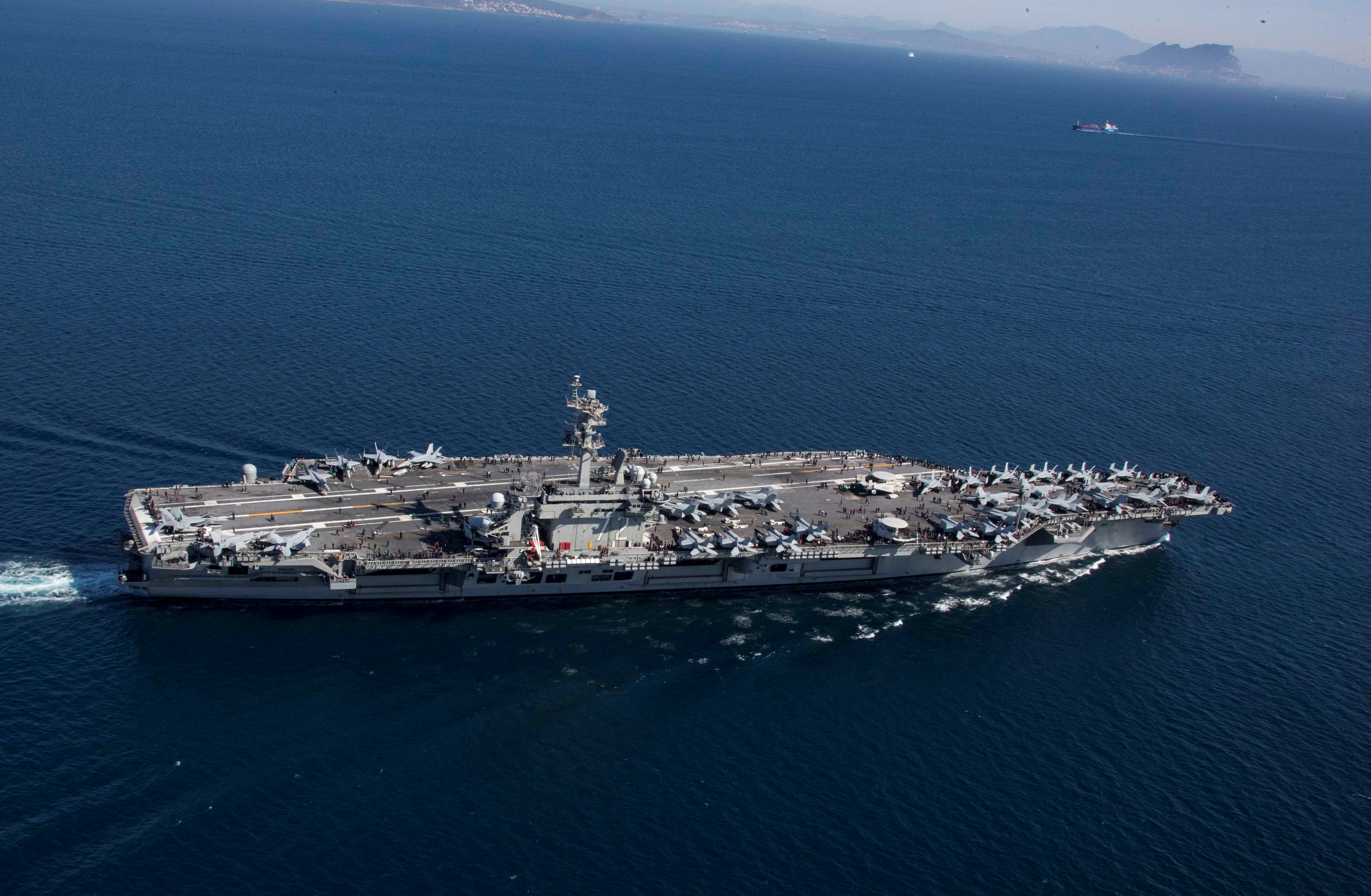 The Nimitz-class aircraft carrier USS Abraham Lincoln transits the Strait of Gibraltar, entering the Mediterranean Sea as it continues operations in the 6th Fleet area of responsibility, April 13, 2019.