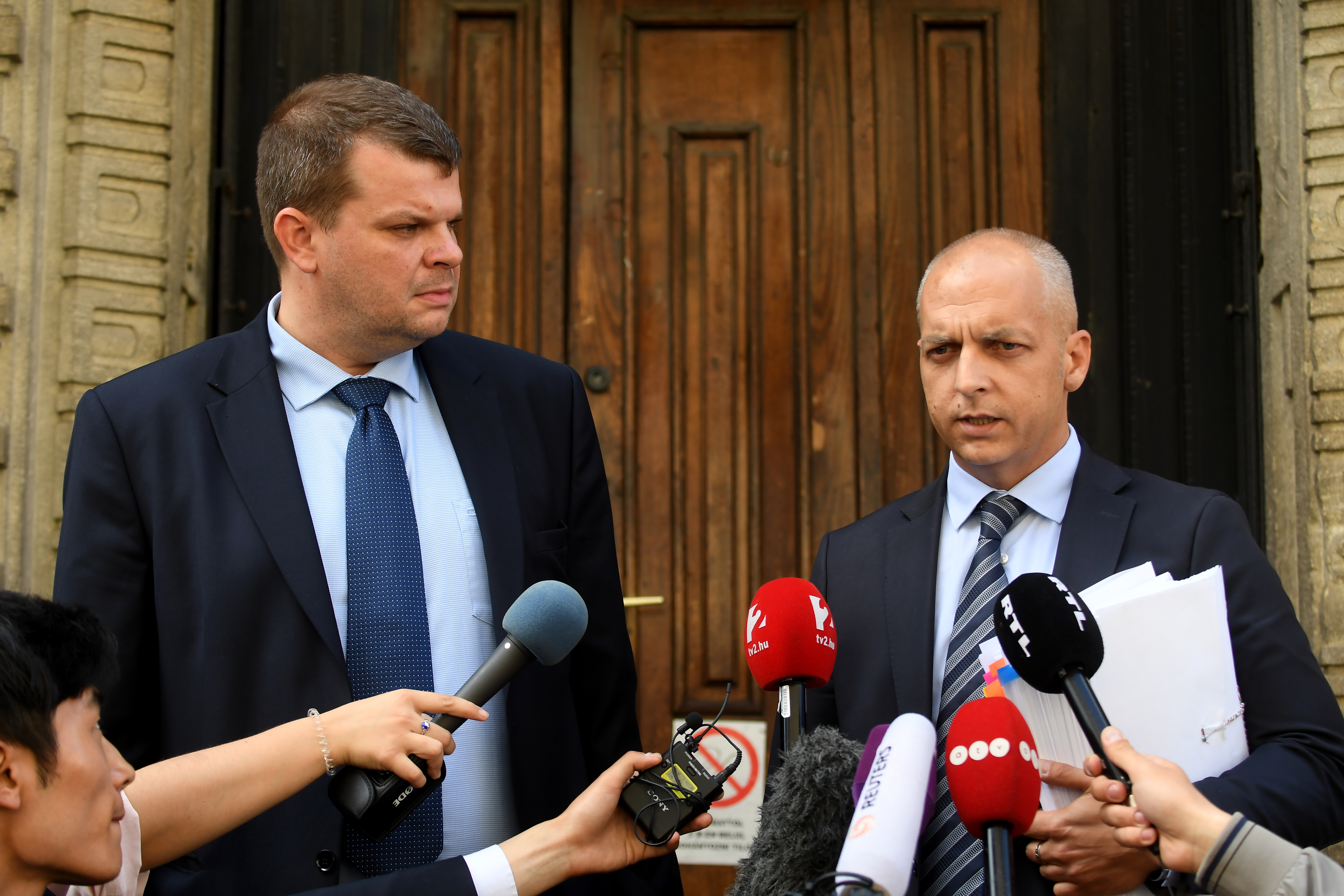 Gabor Elo, left, and Balazs Toth, attorneys for the ship captain charged in a fatal accident on the Danube, talk to reporters in front of the Budapest Court, June 1, 2019.