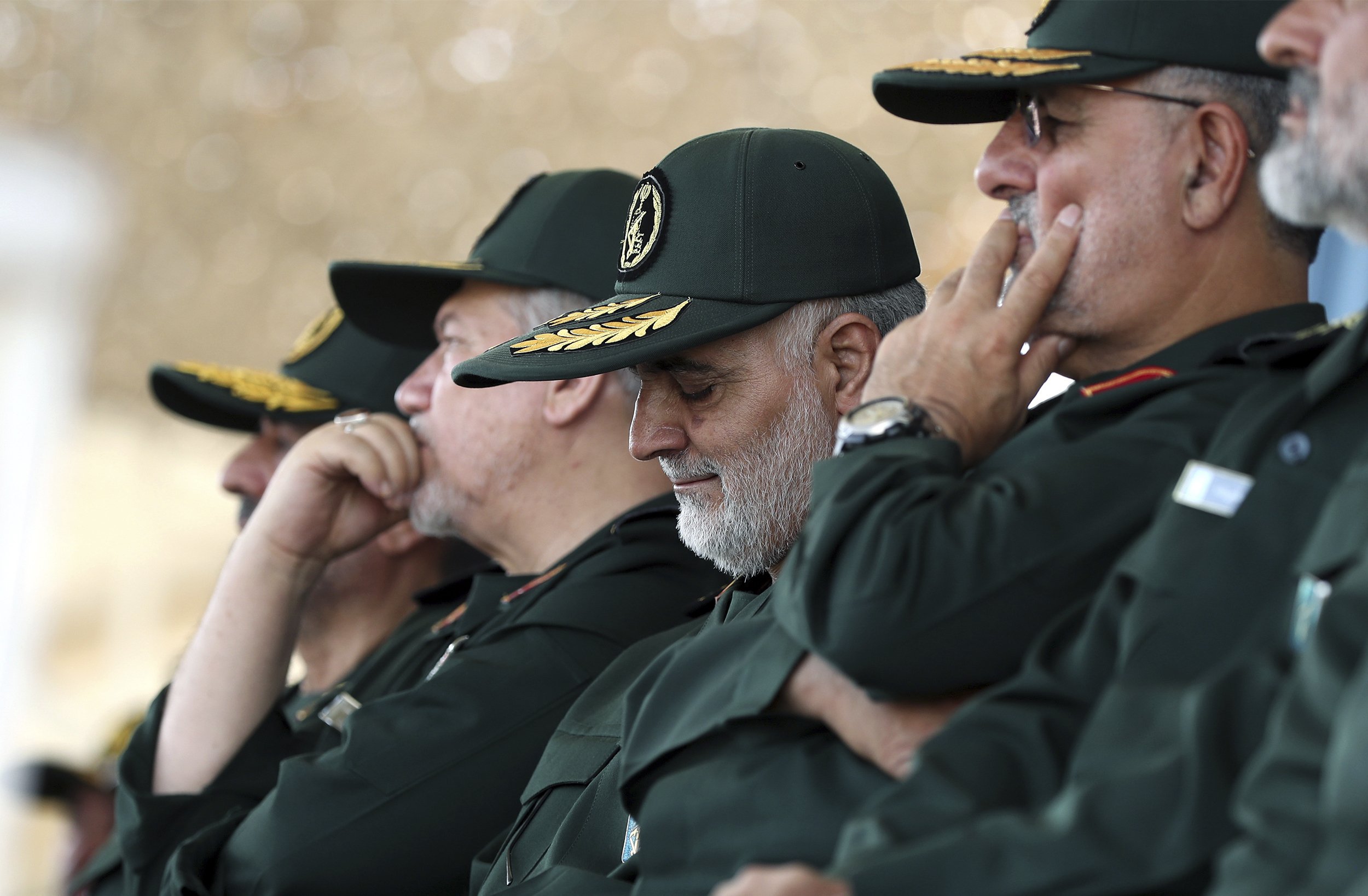 In this June 30, 2018 photo, released by an official website of the office of the Iranian supreme leader, Gen. Qassem Soleimani, center, who heads the elite Quds Force of Iran's Revolutionary Guard attends a graduation ceremony of a group of the guar...