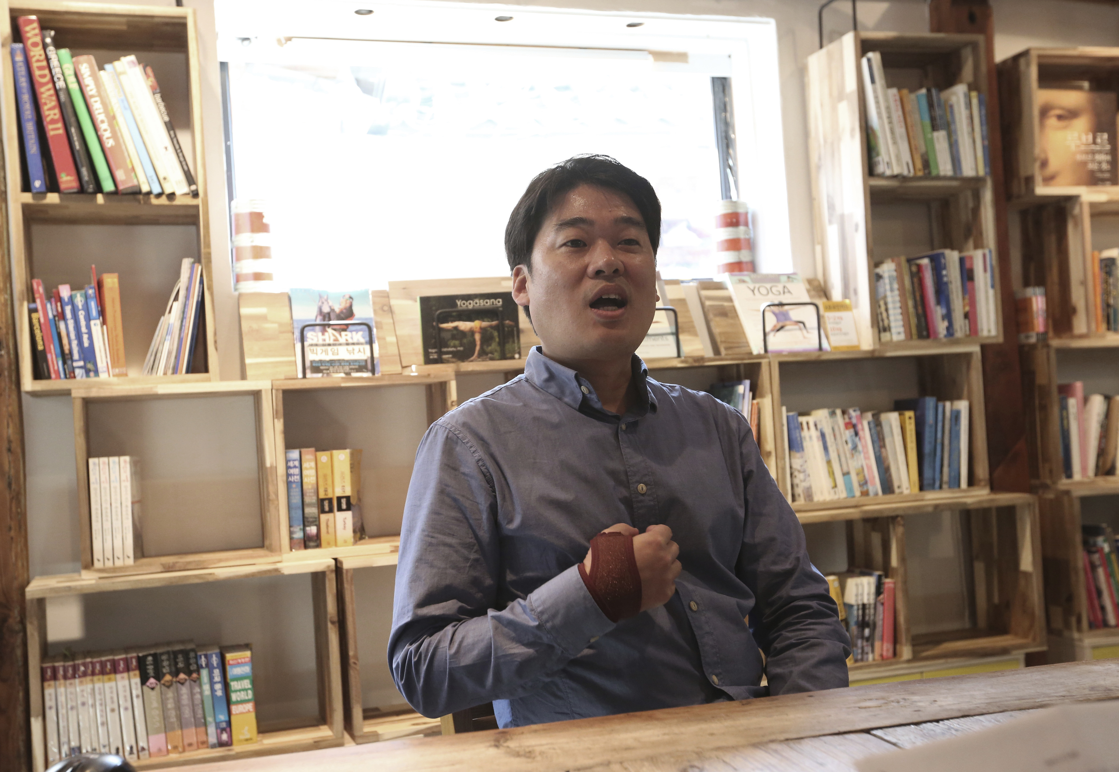 """Lim KyoungJae, 46, head of the Seoul-based Miko Travel agency, speaks at his office in Seoul, South Korea, April 3, 2019. """"If we use international age, things could get more complicated because it's a society that cares so much about which year ..."""