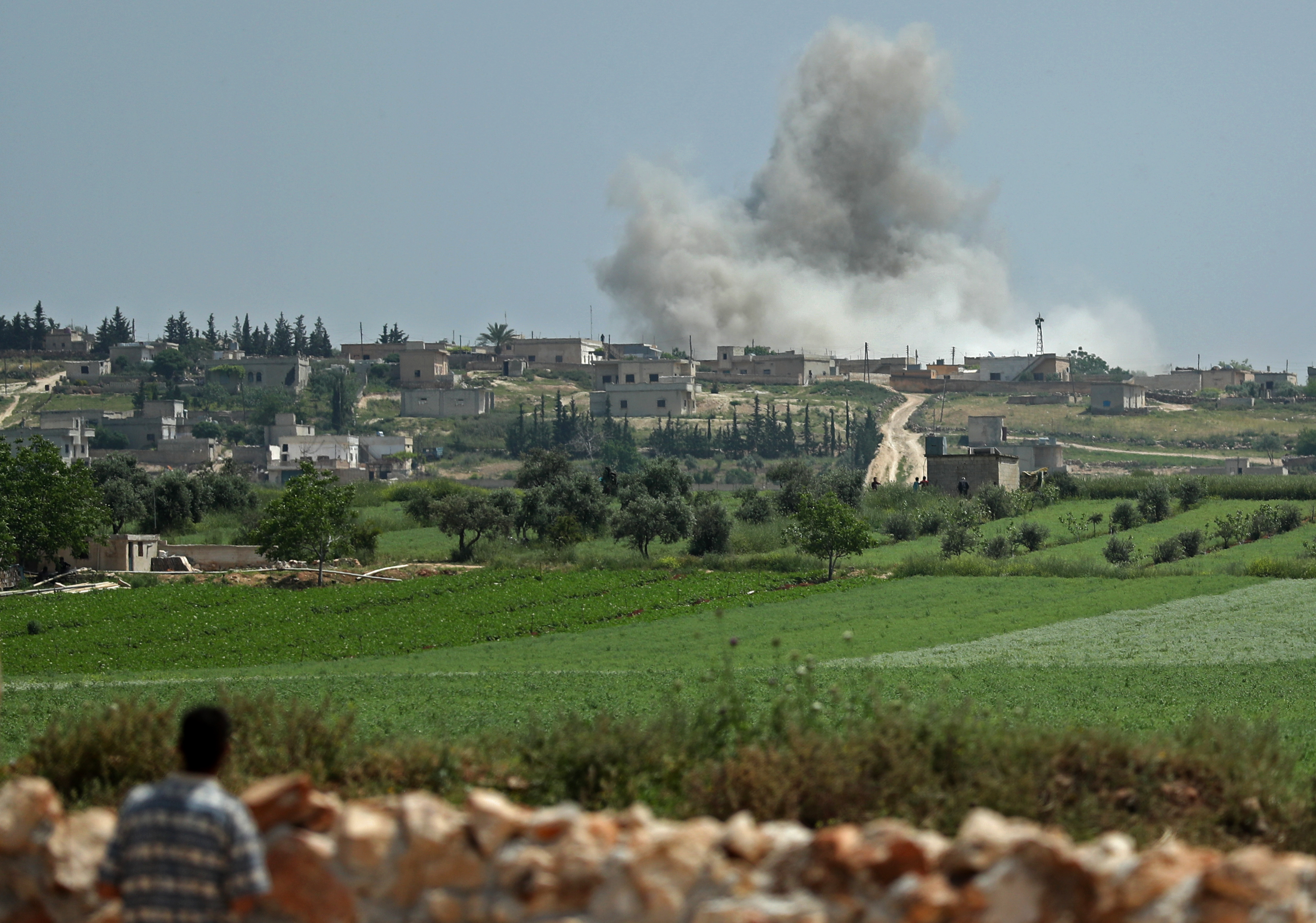 Smoke billows after reported shelling on the Syrian village of Kafr Ein in the southern countryside of the jihadist-held Idlib province, Syria, May 2, 2019.