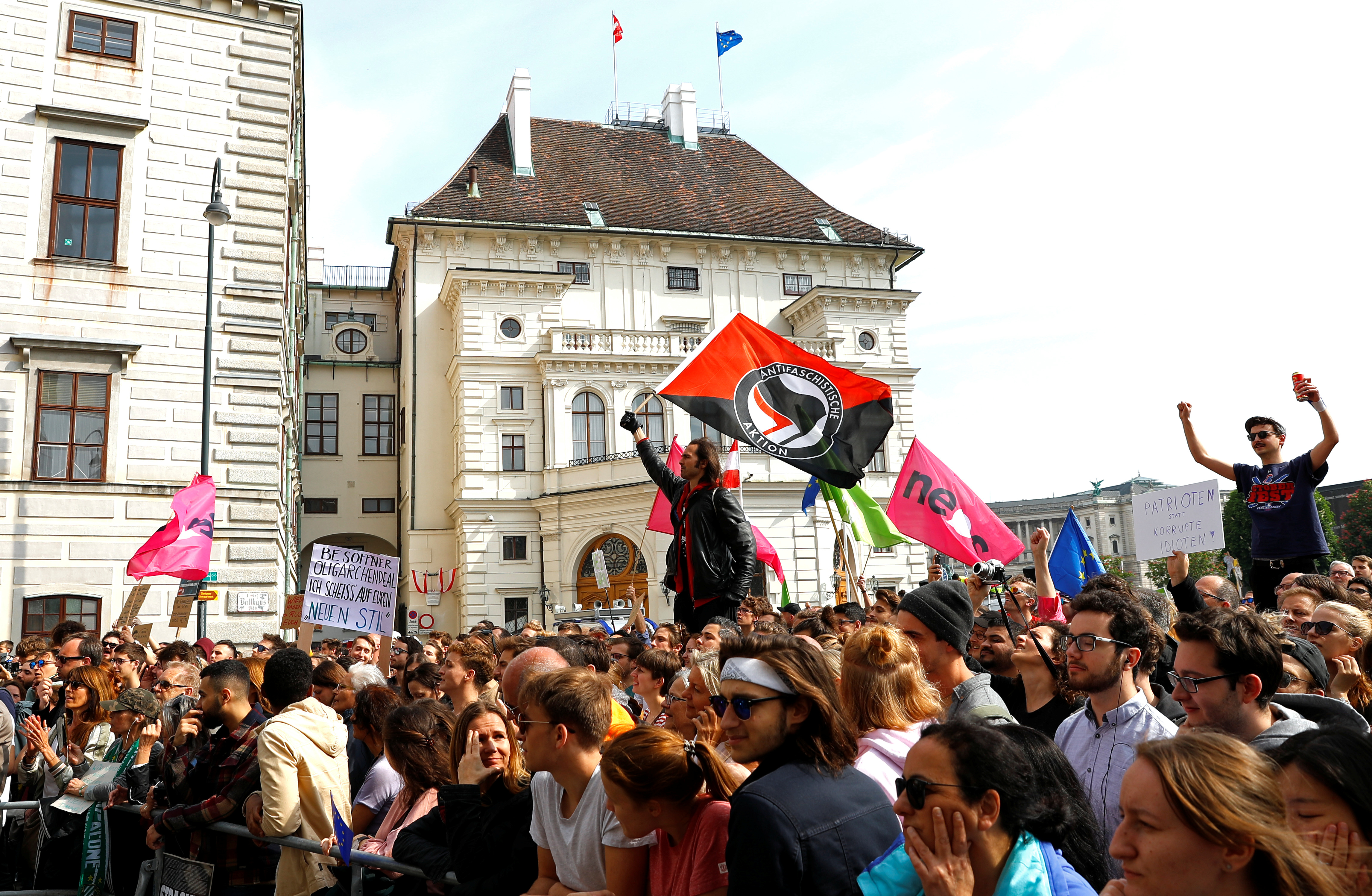 People protest in front of the Chancellery in Vienna, Austria, May 18, 2019.