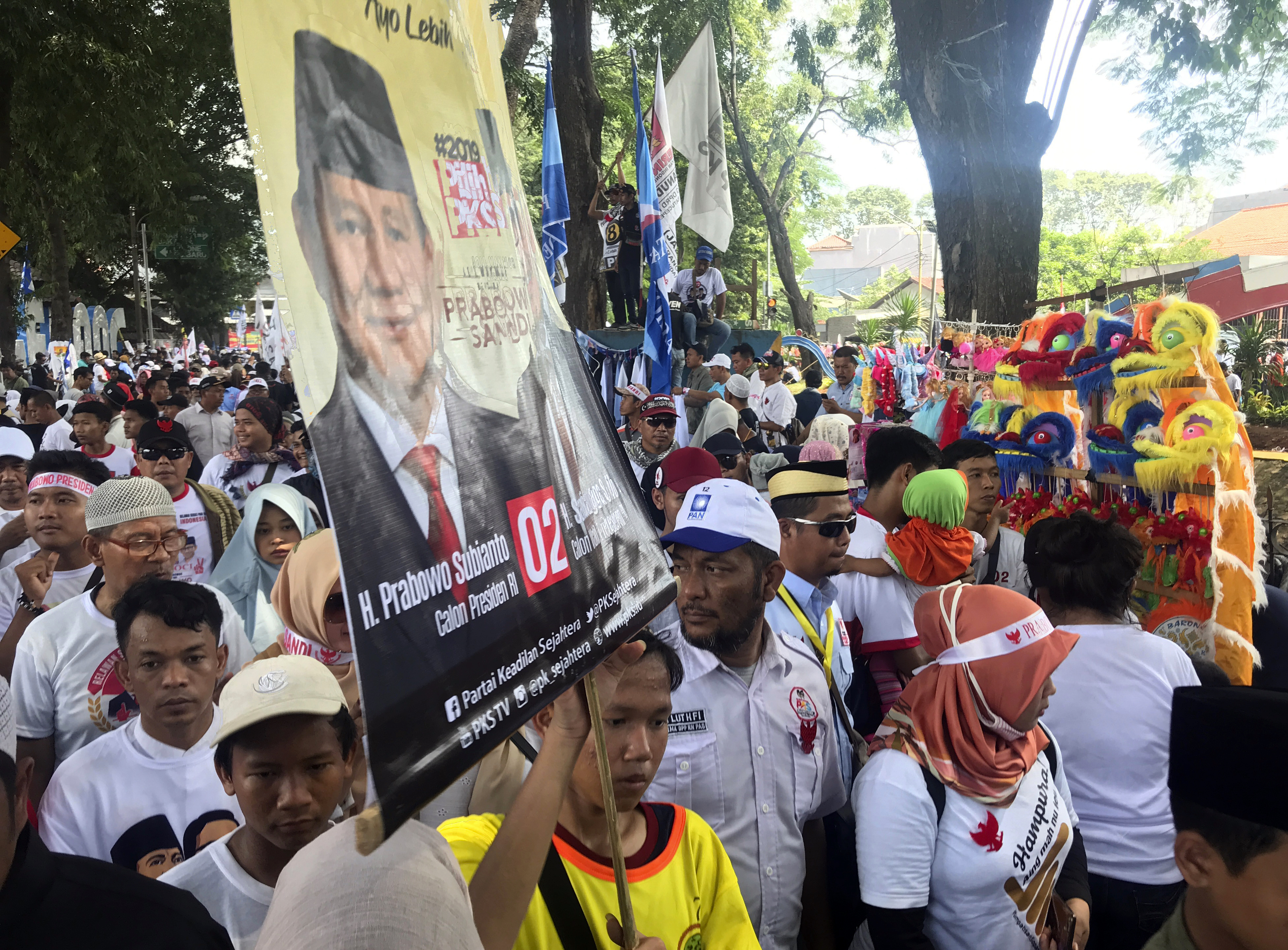 Supporters hold a banner showing support for presidential candidate Prabowo Subianto during a campaign rally in Tangerang, Indonesia, April 13, 2019.