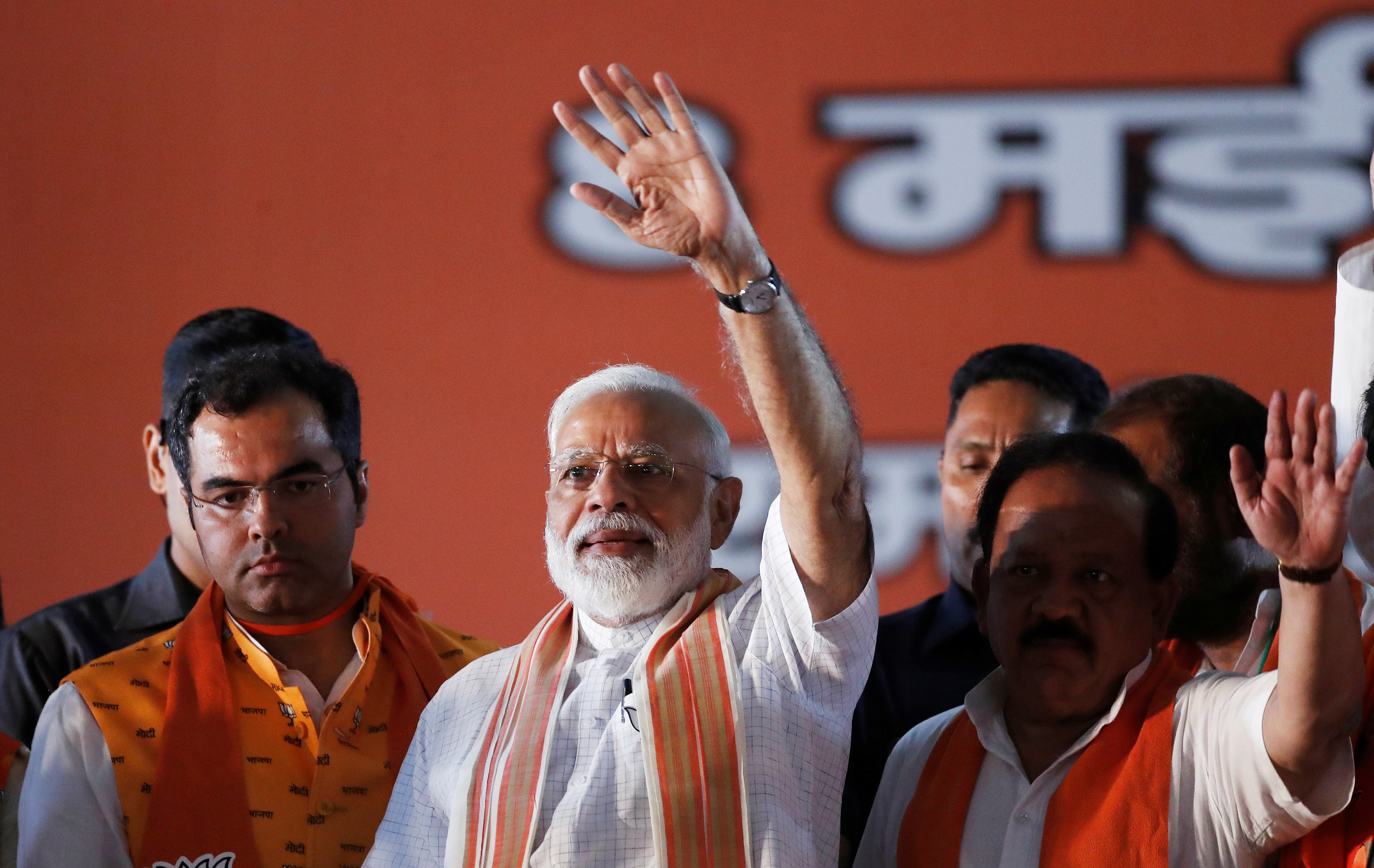 India's Prime Minister Narendra Modi waves toward his supporters during an election campaign rally in New Delhi, May 8, 2019.