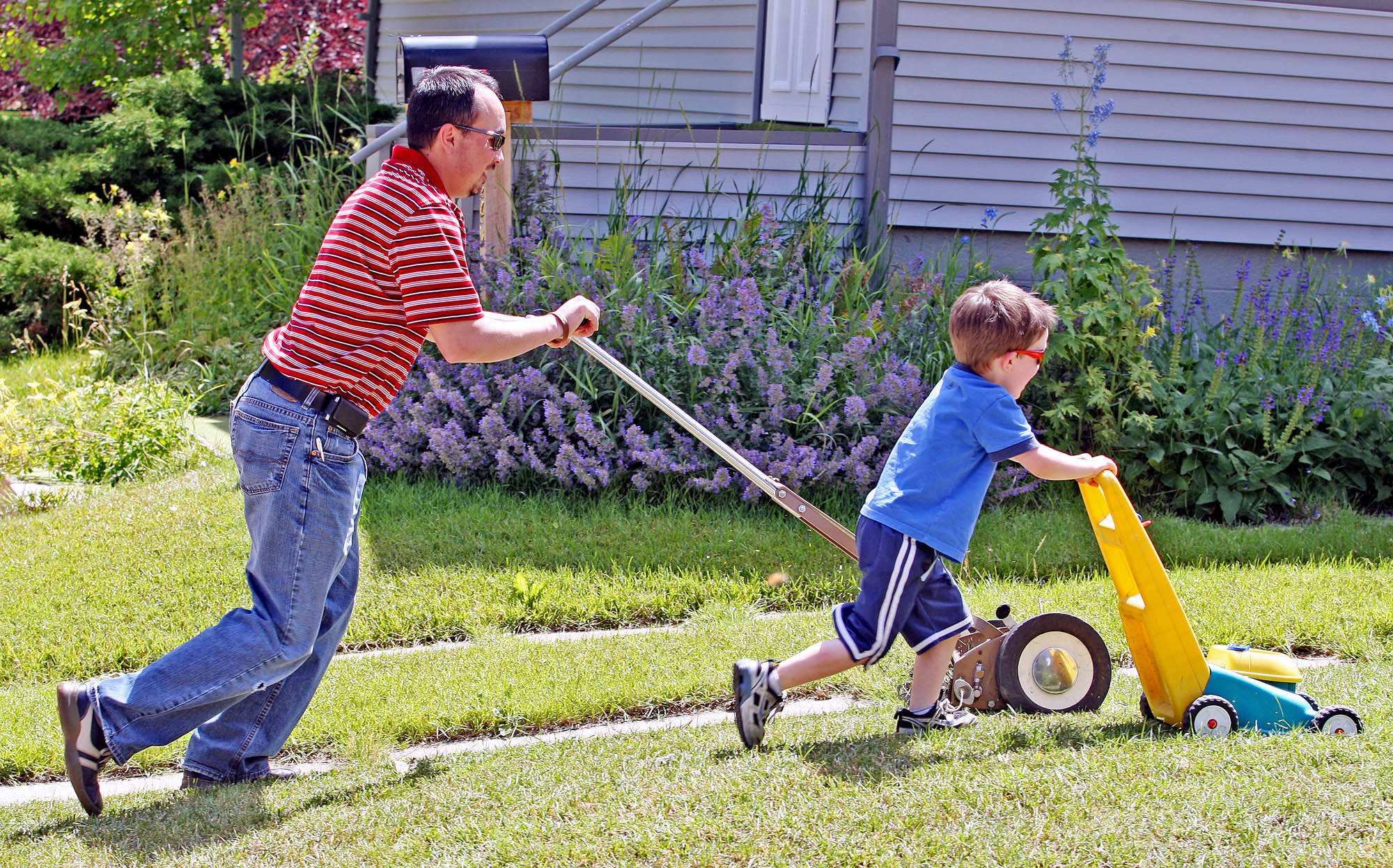 FILE -- Many American children learn about lawn care early on, Laramie, Wyoming.