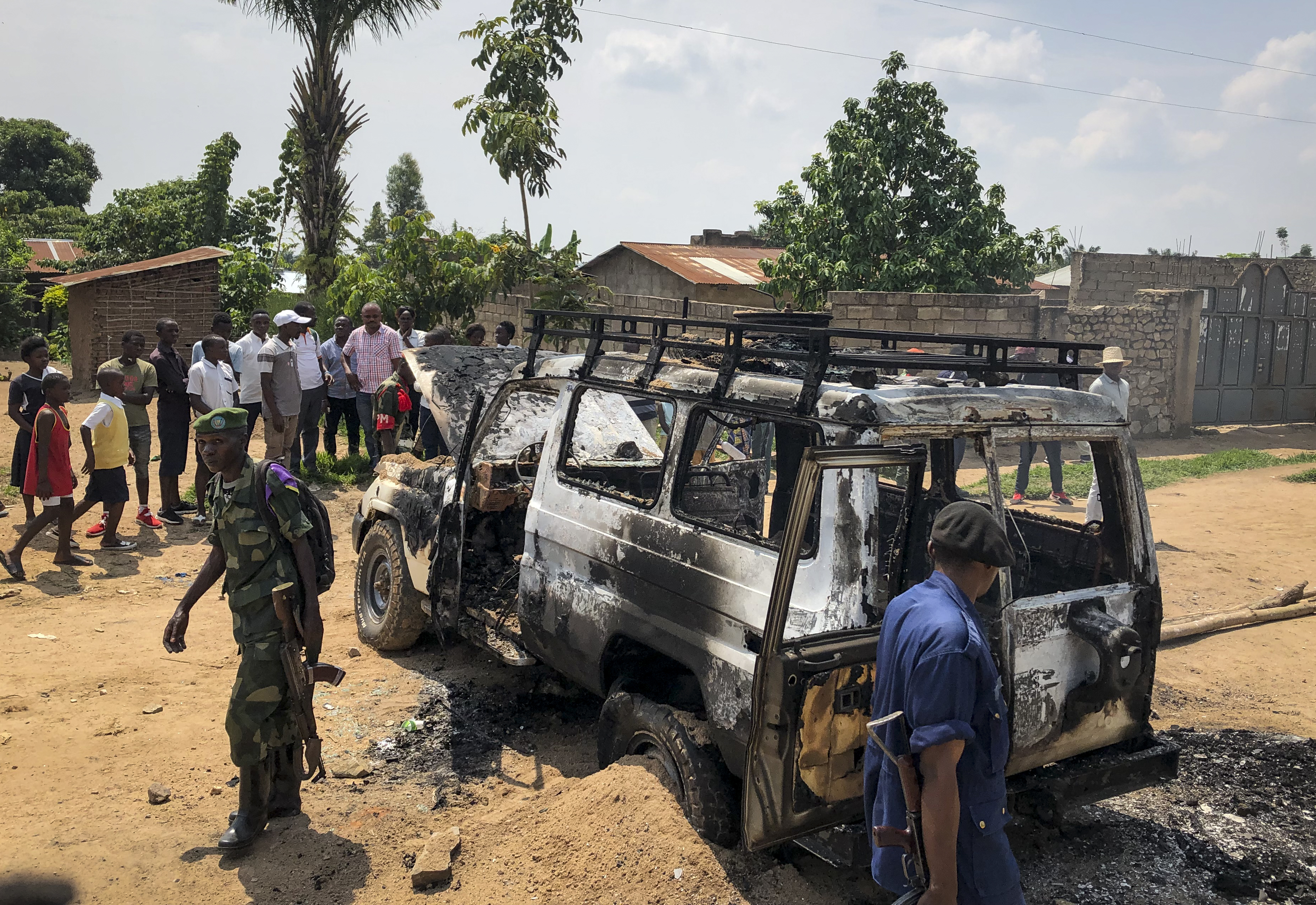 The security forces in Konstanka take part in the scene after the vehicle was attacked by the team responsible for the ebol of the health ministry in Benin, northeastern Congo, on Monday, June 24, 2019.
