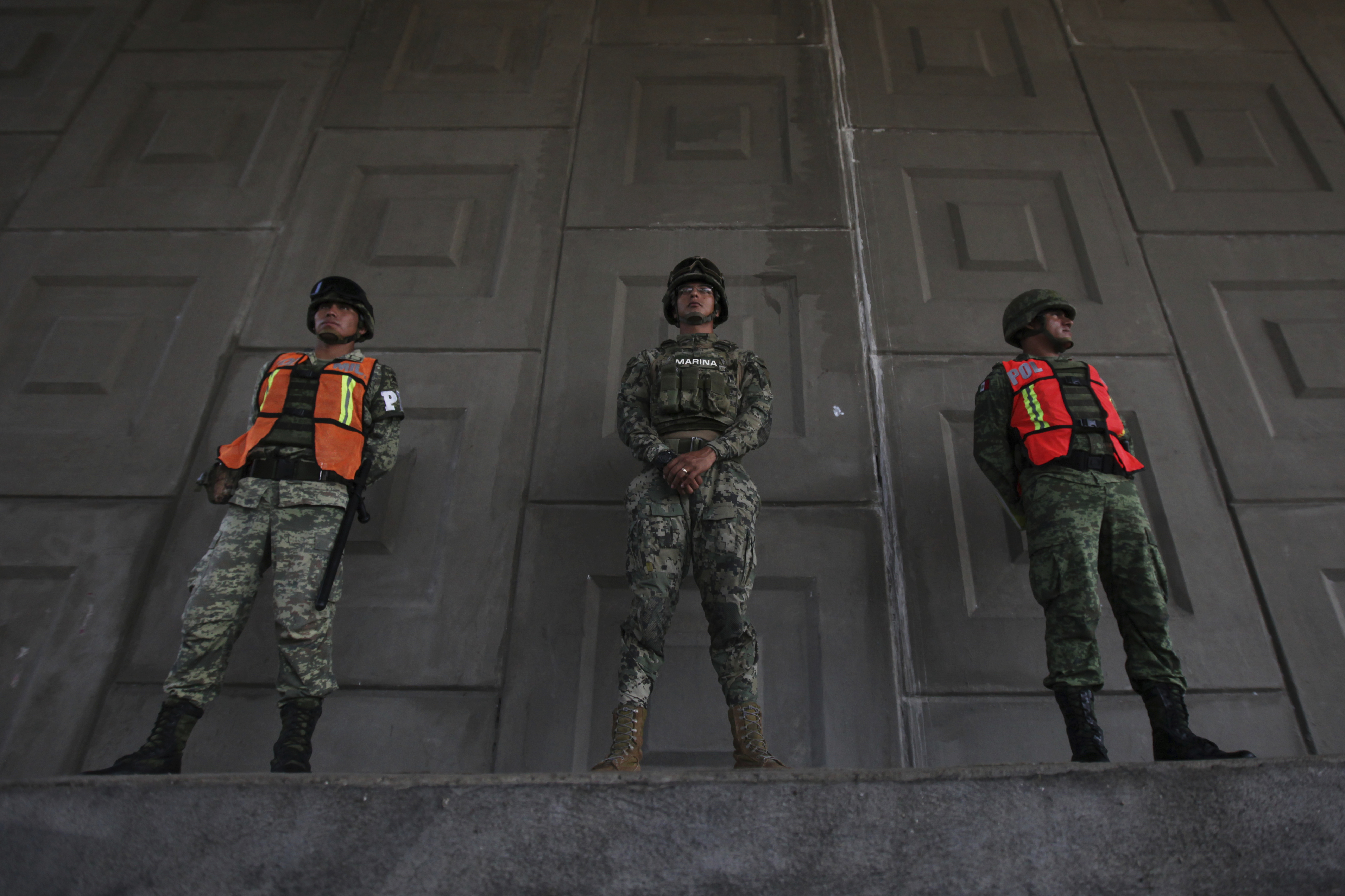 Soldiers stand guard to watch for passing migrants riding in public transportation in Tapachula, Chiapas state, Mexico, Sunday, June 9, 2019. Mexican and U.S. officials reached an accord late Friday that calls on Mexico to crackdown on migrants in…