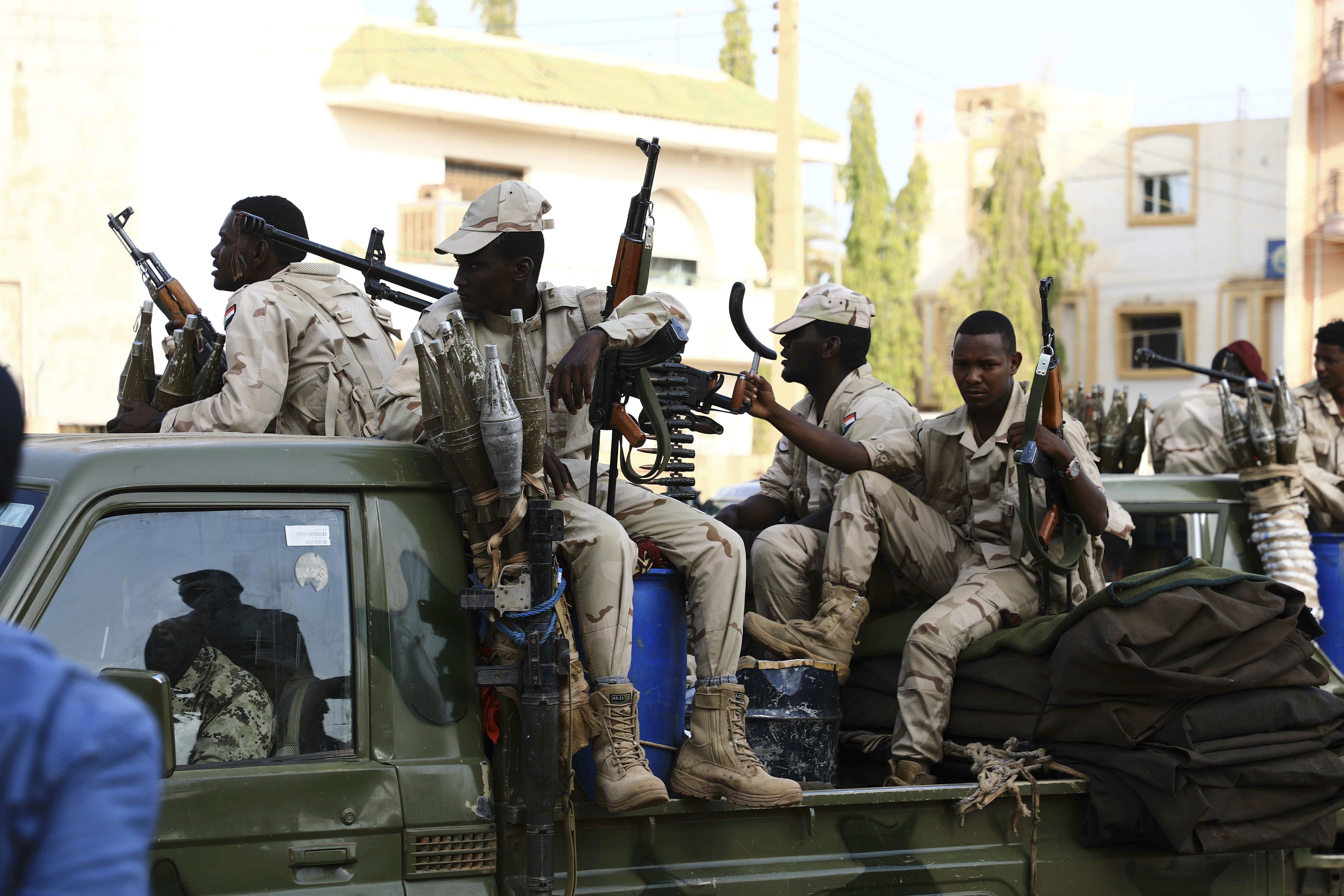 Military forces secure the area outside while Sudan's ousted president Omar al-Bashir is questioned at the prosecutor's office over charges of corruption and illegal possession of foreign currency, in Khartoum, June 16, 2019.