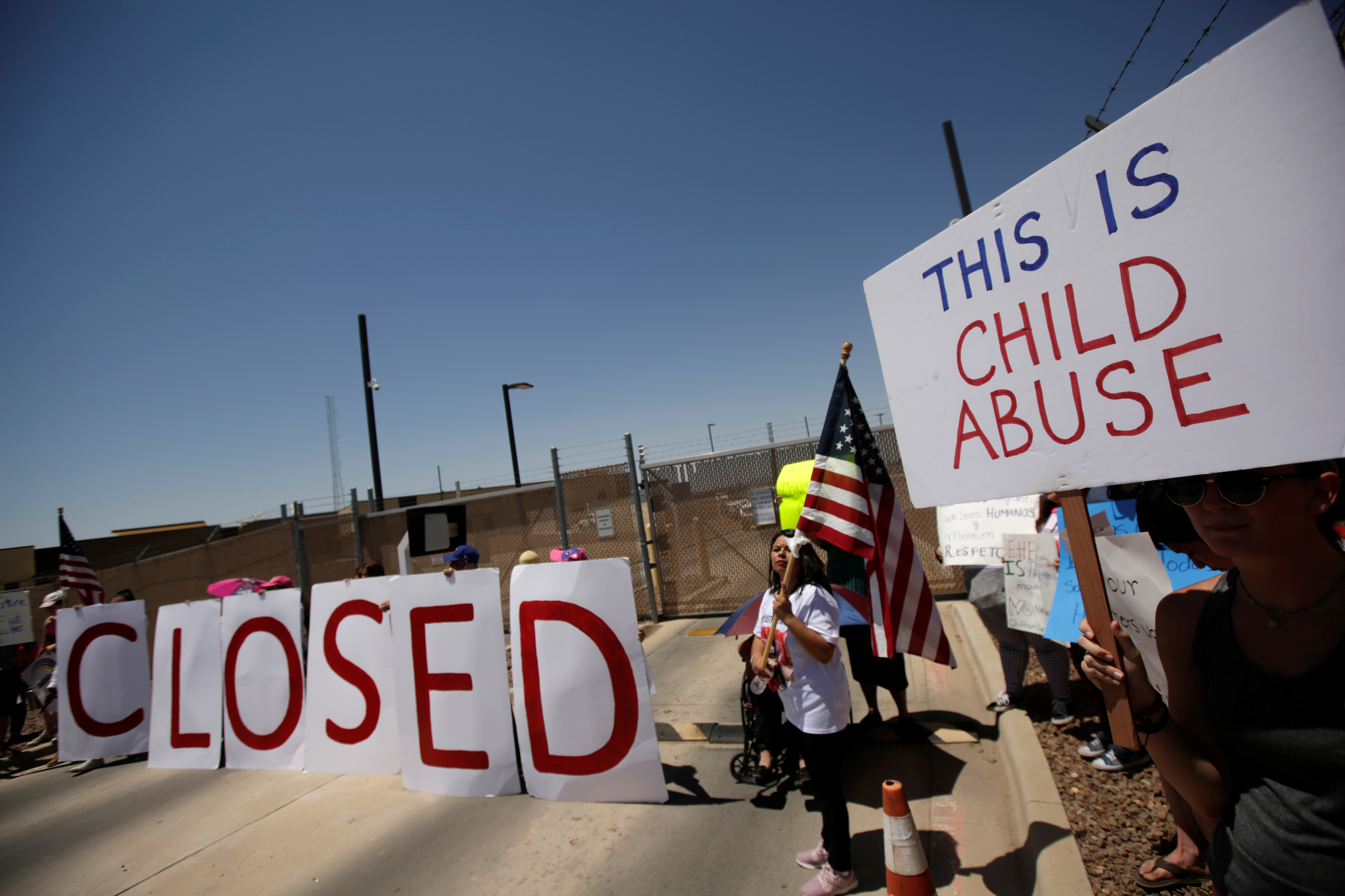 Activists hold a protest against the treatment and conditions of children in immigration detention outside U.S. Customs and Border Protection's Border Patrol station facilities in Clint, Texas