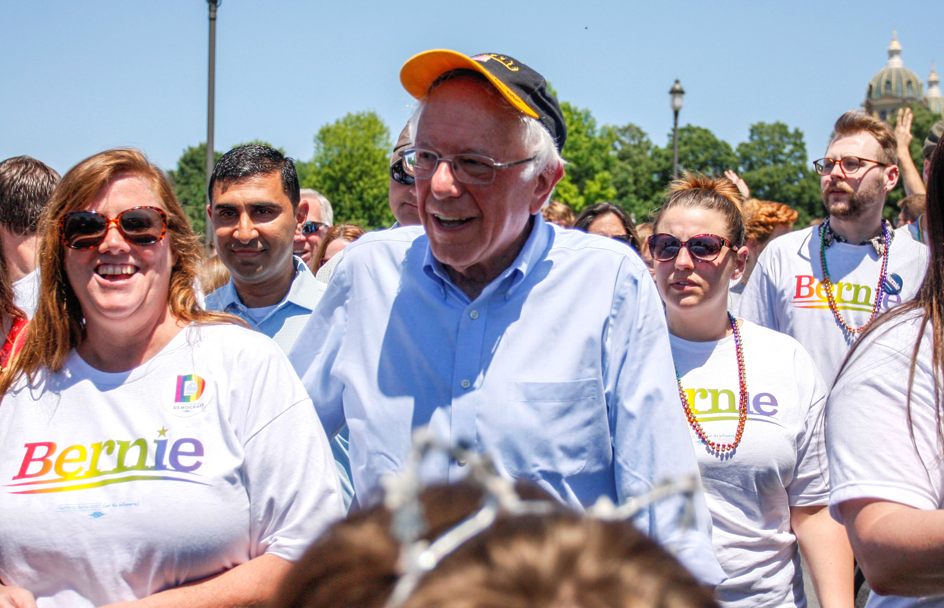 Democratic 2020 U.S. presidential candidate Senator Bernie Sanders walks with supporters as he campaigns at the Capital Pride LGBTQ gay pride celebration at the Iowa State Capitol in Des Moines, Iowa, June 8, 2019.