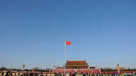 FILE - A Chinese flag flutters against blue sky in Tiananmen Square in Beijing, China, Dec. 24, 2017.