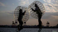 "Ryoichi Ando (R), 27, a virtual-reality researcher and an inventor of ""Bubble Jumper"", competes with his opponent as they demonstrate the sport in Tokyo, Japan, April 13, 2017."