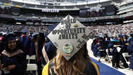 A graduate from Fairleigh Dickinson University wears her cap before the start of the school's commencement ceremony, May 16, 2017, at MetLife Stadium in East Rutherford, N.J.