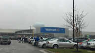 Shoppers walk in the parking lot of a Walmart store in Fairfax, Virginia. (Photo: Diaa Bekheet) Walmart says it will stop selling ammunition for handguns and assault-style weapons.