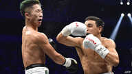 Nordine Oubaali of France (R) fights with of Japan's Takuma Inoue during their WBC bantamweight title boxing match at Saitama Super Arena in Saitama, Japan.