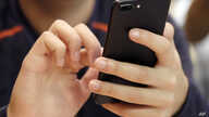 FILE - In this Sept. 16, 2017, file photo, a person uses a smart phone in Chicago. For many of us, a smartphone addiction is…