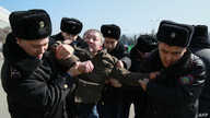 Kazakh police detain a protester in Almaty on March 1, 2020. - Police in authoritarian Kazakhstan detained more than 60 people…