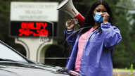 In this May 27, 2020, photo, health care worker Tonya Wilkes adjusts her mask while working at a Lowndes County coronavirus…