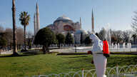 A worker in protective suit disinfects Sultanahmet square in response to the spread of coronavirus disease (COVID-19) in…