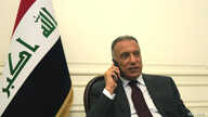 Iraqi Prime Minister Mustafa al-Kadhimi uses his mobile phone at his office in Baghdad, Iraq May 9, 2020. Picture taken May 9,…