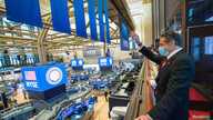 New York Governor Andrew Cuomo rings the opening bell at the New York Stock Exchange (NYSE) as the building opens for the first…