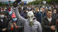 A man, wearing a mask to protect against coronavirus, attends a rally to support for potential presidential candidates