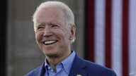 FILE - In this March 7, 2020, file photo, Democratic presidential candidate former Vice President Joe Biden acknowledges the…