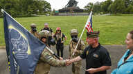 A group of veterans with Operation Enduring Warrior greet Brian Willette with the Veterans of Foreign Wars, and his wife Gina.
