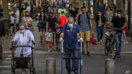 People walk on a street in Barcelona, May 25, 2020.