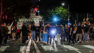 Demonstrators block traffic during a protest Wednesday, May 27, 2020, in Los Angeles over the death of George Floyd in Minneapolis police custody earlier in the week.