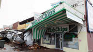 A row of shops is seen after sustaining damage in the Perth suburb of Bedford, Australia, May 25, 2020, after the area was lashed by gale force winds and a tidal surge.