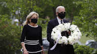 Democratic presidential candidate, former Vice President Joe Biden, and his wife Jill Biden arrive to place a wreath at the Delaware Memorial Bridge Veterans Memorial Park, in New Castle, Delaware, May 25, 2020.