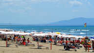 People enjoy a sunny day on the beach in Tuscany's Castiglione della Pescaia, Italy, May 24, 2020.