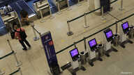 FILE - Passengers check in at a Latam Airlines counter in Santos Dumont Airport during the coronavirus pandemic, in Rio de Janeiro, Brazil, May 20, 2020.