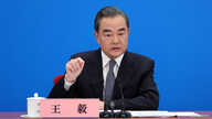 Chinese Foreign Minister Wang Yi speaks to reporters via video link at a news conference held on the sidelines of the National People's Congress (NPC), from the Great Hall of the People in Beijing, China, May 24, 2020.