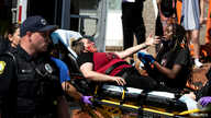 An injured protester is attended to in Columbia, South Carolina, during a rally against the death of George Floyd in Minneapolis police custody, May 30, 2020.