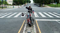 U.S. Marine SSGT Tim Chambers renders a salute, paying respect for veterans on Washington's Constitution Avenue, now empty in the midst of the COVID-19 pandemic, as people commemorate the Memorial Day holiday.