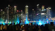 FILE - A light show lights up Singapore's waterfront before the coronavirus pandemic.