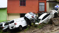Cars damaged and swept during floods caused by Tropical Storm Cristobal, are seen in Panchimalco, El Salvador, on June 3, 2020…