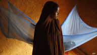 FILE- In this Wednesday, July 18, 2012, file photo, Zali Idy, 12, poses in her bedroom in the remote village of Hawkantaki,…