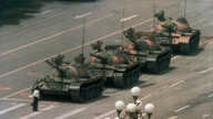 FILE - In this June 5, 1989, file photo, a Chinese man stands alone to block a line of tanks heading east on Beijing's Changan…