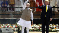 U.S. President Donald Trump and Indian Prime Minister Narendra Modi wave to the crowd at Sardar Patel Stadium in Ahmedabad,…