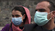 Afghan journalists wear face masks during a coverage of a campaign to raise awareness of the new coronavirus in Kabul, Afghanistan, March 16, 2020.